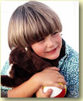 Graphic image of a young boy hugging his teddy bear